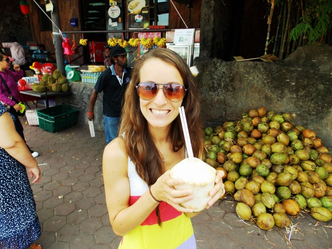 Sippin on some delicious and fresh coconut juice.