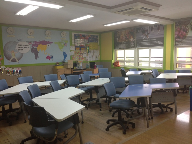 "Getting ready to change the desks in my classroom into groups. I don't miss this typical ""korean style"" of desks in rows. Ick!"